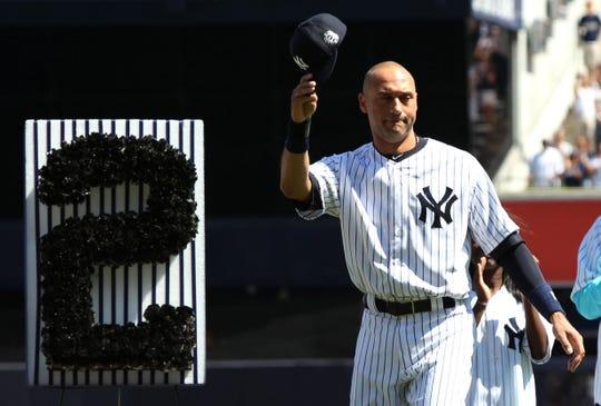 Derek Jeter acknowledges fans as he is honored at Yankee Stadium in 2016.
