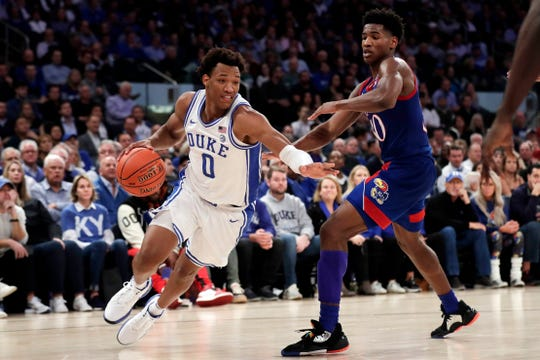 Duke forward Wendell Moore Jr. drives to the basket past Kansas guard Ochai Agbaji during the second half of their game at Madison Square Garden on Nov. 5, 2019.