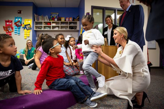 "Ivanka Trump visits a day care attached to Metropolitan Community College in Kansas City on Oct. 10. She is advising her father, President Donald Trump, on child care and paid family leave. As much as she believes her ""efforts are bearing fruit,"" Trump said she will have viewed her work ""as a failure if we don't pass legislation."""