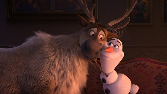 "Trusty reindeer Sven cuddles up with snowman Olaf (voiced by Josh Gad) in ""Frozen 2."""