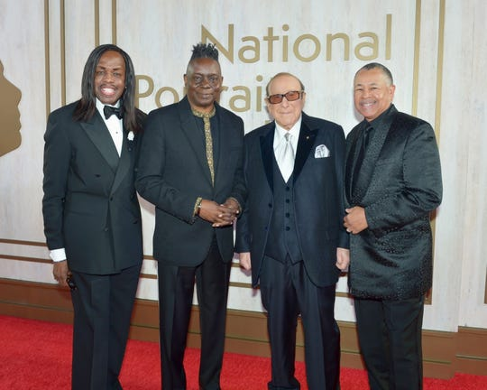 Earth, Wind and Fire members Verdine White, left, Philip Bailey and Ralph Johnson, right, with producer Clive Davis