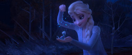 "Elsa (voiced by Idina Menzel) makes a new friend in the magical salamander Bruni in the animated sequel ""Frozen 2."""