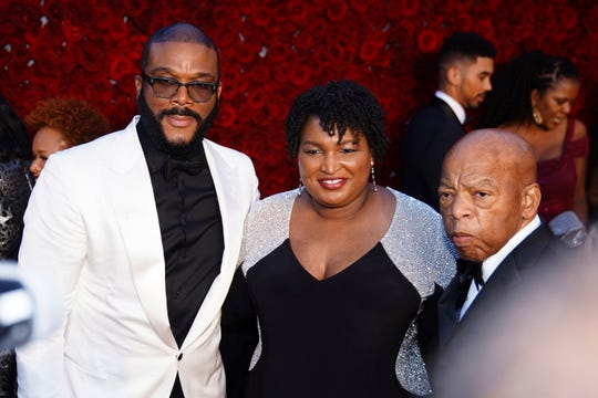 Tyler Perry, Stacey Abrams, and U.S. Rep. John Lewis, D-Ga., pose for a photo on the red carpet at the grand opening of Tyler Perry Studios, Saturday, Oct. 5, 2019, in Atlanta.
