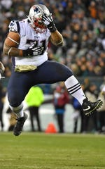 New England Patriots defensive tackle Danny Shelton (71) celebrates after sacking Philadelphia Eagles quarterback Carson Wentz and causing a fumble during the second quarter at Lincoln Financial Field.
