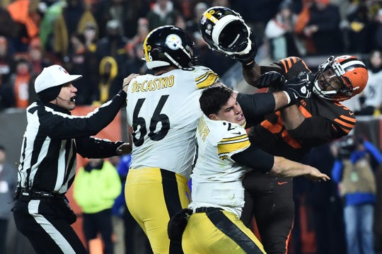 Cleveland Browns defensive end Myles Garrett hits Pittsburgh Steelers quarterback Mason Rudolph with the QB's helmet on Thursday night.