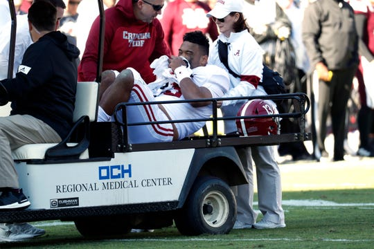 Alabama quarterback Tua Tagovailoa is carted off the field after getting injured during the first half against Mississippi State.