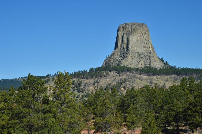 Devils Tower National Monument looms 1,267 feet above the Belle Fourche river in Eastern Wyoming.