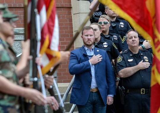Sheriff Chad McBride, left, and Anderson Chief Jim Stewart salute as the Electric City Young Marines present colors for the 2019 Peace Officer Memorial Service last May. Deputies in the Anderson County Sheriff's Office do not have body cameras, despite neighboring city officers wearing them, and formerGov. Nikki Haley signing a law in June 2015 requiring all law enforcement agencies to have them. The City of Anderson police have been using them for a few years.