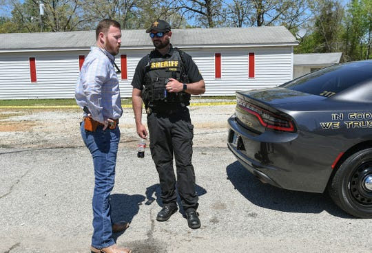 Anderson County Sheriff Chad McBride, left, and public information officer J.T. Foster at the scene of a shooting on Hwy 29 last April. Deputies in the Anderson County Sheriff's Office do not have body cameras, despite formerGov. Nikki Haley signing a law in June 2015 requiring all law enforcement agencies to have them. The City of Anderson police have been using them for a few years.