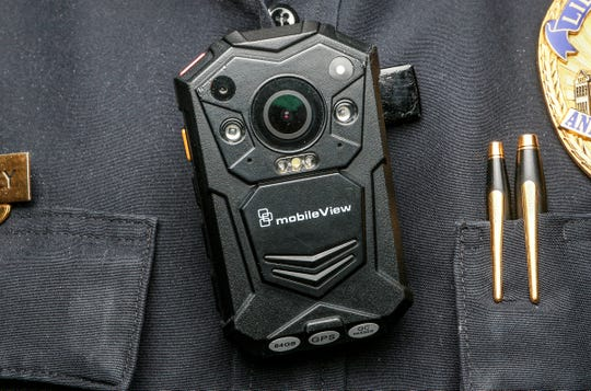 An Anderson police officer wears a MobileView police body camera at the police department in Anderson. The city upgraded cameras and docking station, placing cameras on all police officers for use with any interaction with the pubic. Deputies in the Anderson County Sheriff's Office do not have body cameras, despite formerGov. Nikki Haley signing a law in June 2015 requiring all law enforcement agencies to have them. The City of Anderson police have been using them for a few years.