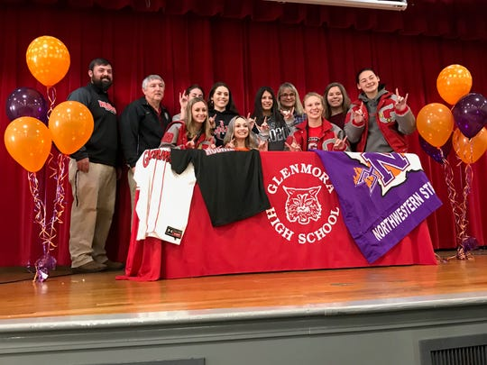 Glenmora pitcher Abbott Stafford (center) signed with Northwestern State Monday.