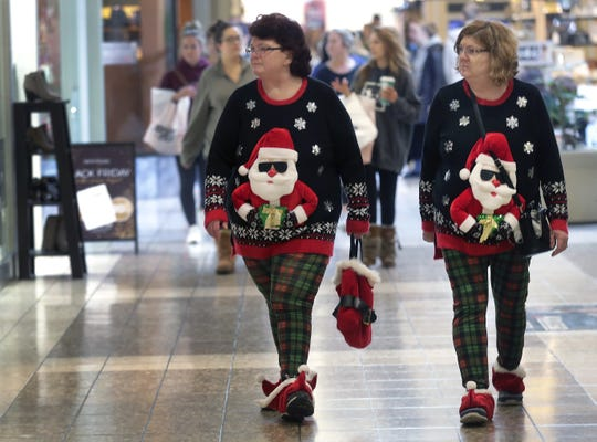 Teresa Black, left, and Alice Keel dressed for the holidays while shopping on Black Friday  at the Fox River Mall in this 2018 archive photo.