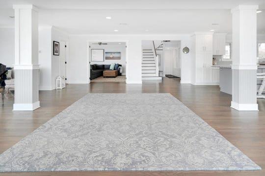 The open floor plan offers an abundance of natural lighting.