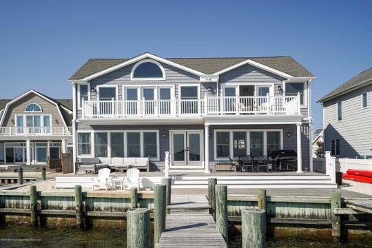 The back of the home offers an upgraded deck and custom windows.