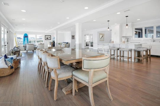 The dining area features recessed lighting and hardwood floors.