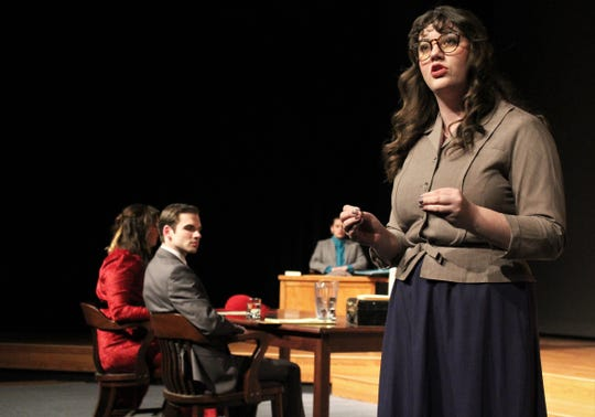 """The prosecutor (Madison Murgia) speaks to the death of business tycoon Bjorn Faulkner, which she believes is murder, in this rehearsal scene from """"The Night of January 16th,"""" on stage at Hardin-Simmons University."""