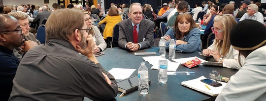 Scott Good, with the Maine-based firm Crescendo Consulting Group, speaks with a group during a discussion time at Monday evening's ThriveABI meeting at the Abilene Convention Center.