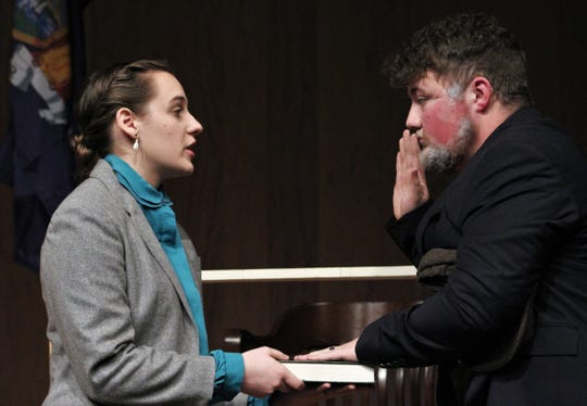 """A witness (Dylan Scott) is sworn in by a court administrator (Brooke Rodgers) in this rehearsal scene from """"The Night of January 16th."""""""