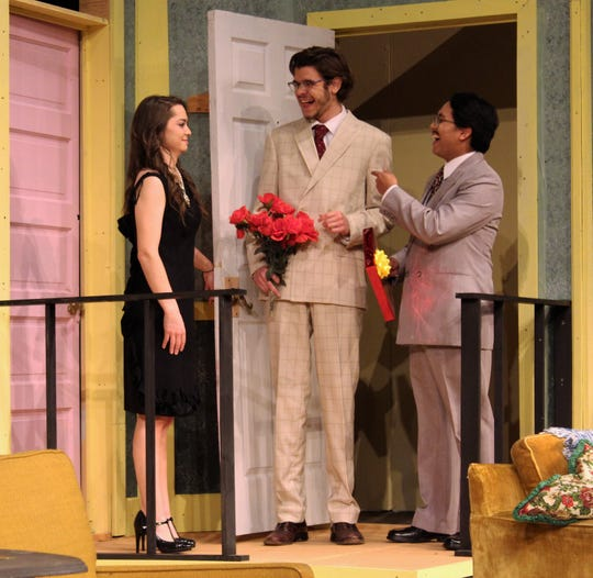 "Olive (Hayli Isbell) greets the Costazuela brothers, Manolo (Jared Hainsel, center) and Jesus (Elmer Mejia), who bring flowers, candy and confusion to the apartment in this rehearsal scene from McMurry University's presentation of the female version of ""The Odd Couple"" at Ryan Little Theatre."