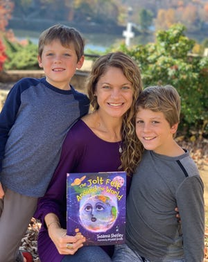Haywood County author Susanna Shetley with her sons and her first book, inspired by her boys.