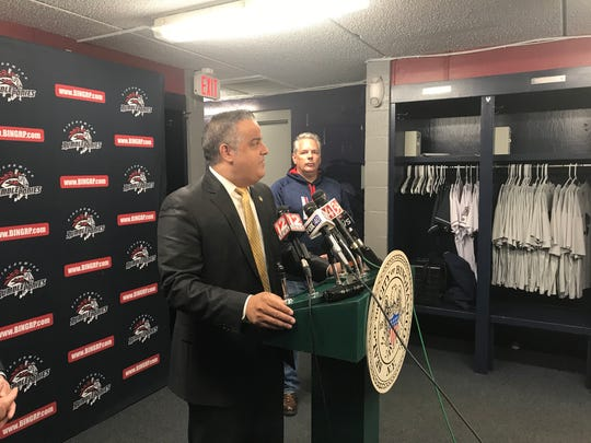 City of Binghamton Mayor Richard David speaks at a news conference Tuesday about the possibility of the Binghamton Rumble Ponies ceasing to exist if a proposal by Major League Baseball is approved. Rumble Ponies owner John Hughes, right, looks on.