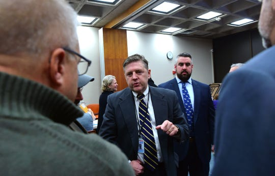 Broome County Board of Elections Democratic Commissioner Daniel Reynolds, in foreground, and Republican Commissioner Mark Smith, in background, during the absentee ballot count to decide the District Attorney race between Mike Korchak and Paul Battisti on Tuesday, November 19, 2019.