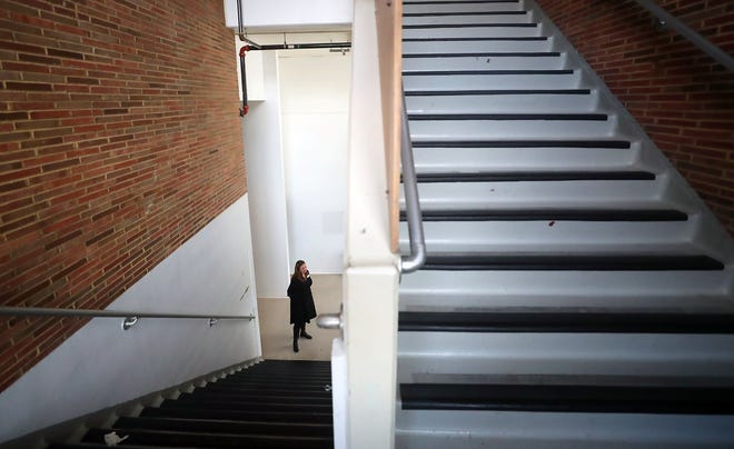 Catalyst Charter School's Amanda Gardner stands at the bottom of a set of stairs during a tour of the space at Discovery Fellowship Church that the school is renovating on Tuesday.