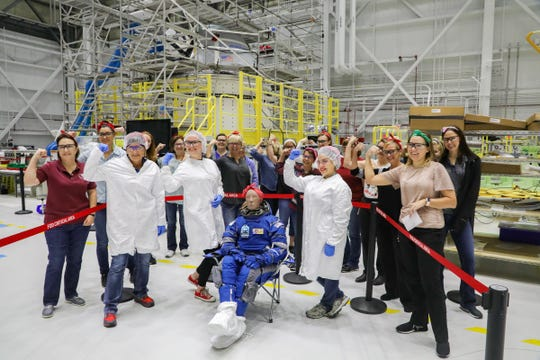 Boeing employees pose with 'Rosie the Astronaut' the anthropometric test dummy, named after Rosie the Riveter, that will fly aboard the first test flight of Starliner CST-100.