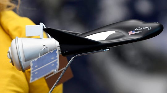 Sierra Nevada Corporation's new cargo module named Shooting Star is shown attached to the Dream Chaser vehicle on a model at Kennedy Space Center