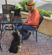 Robin Butto of Merritt Island enjoys breakfast at Ossorio Cafe & Bakery in Cocoa with her dog, Layla.