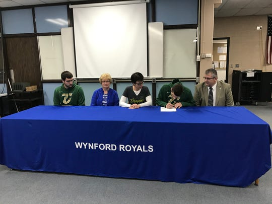 Wynford's Josh Crall signs his letter of intent to attend Tiffin University next year surrounded by his family.
