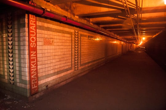 Dingy tiled platform walls of PATCO's long-closed Franklin Square Station underground in Philadelphia just west of the Ben Franklin Bridge. A new high-rise and other development is prompting a plan to reopen and modernize this rail station by 2023.