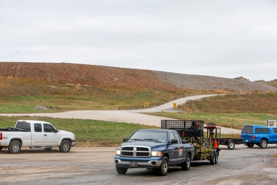 Trucks enter with debris from a wind storm over the weekend at Bi-County Solid Waste Management in Woodlawn, Tenn., on Tuesday, Oct. 29, 2019.