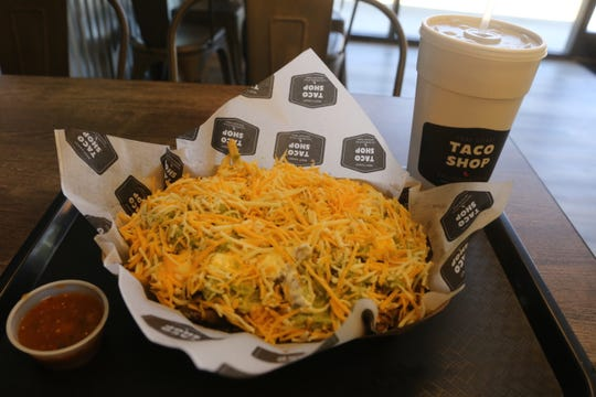 Carne asada fries served up at the second Clarksville location of the popular West Coast Taco Shop which opened last week at 2485 Fort Campbell Blvd.