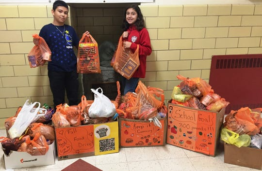Collecting food at Smalley School in Bound Brook are (left to right) Jeysone Menjivar and Sam Jannuzzi.