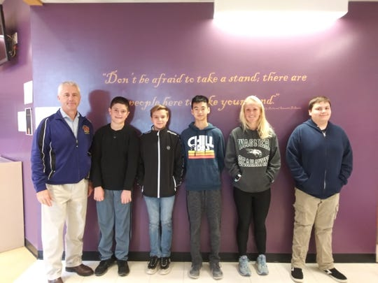 Throughout the school year, the Middle/High School teaching staff nominates students for the student of the month award. The nominations are based on character, school spirit, and academic integrity. For October, the winners are (left to right): Principal Dr. P.  McCabe, and Middle School students: J. Foreman, 6th grade; E. Gurdak, 7th grade and D. Cheng, 8th grade, and High School students:  M. Walsh and M. Bigelow.