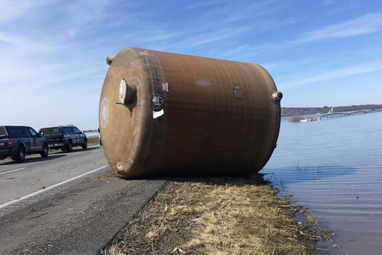 This photo provided by the Missouri Department of Natural Resources taken in Atchison County, Mo. in March 2019 shows one of hundreds of containers — many carrying hazardous materials — that have floated into Missouri since flooding in the upper Missouri River basin during the spring.