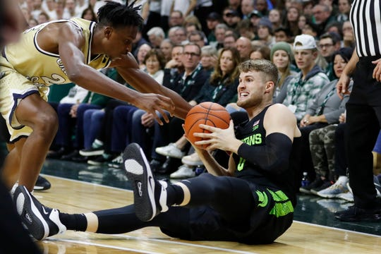 Michigan State guard Kyle Ahrens looks to pass as Charleston Southern guard Phlandrous Fleming Jr. reaches in during the first half Monday, Nov. 18, 2019, in East Lansing.