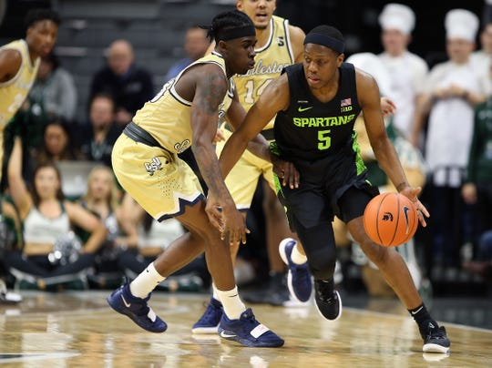 Michigan State guard Cassius Winston is defended by Charleston Southern guard Sean Price during the first half at Breslin Center, Nov. 18, 2019.