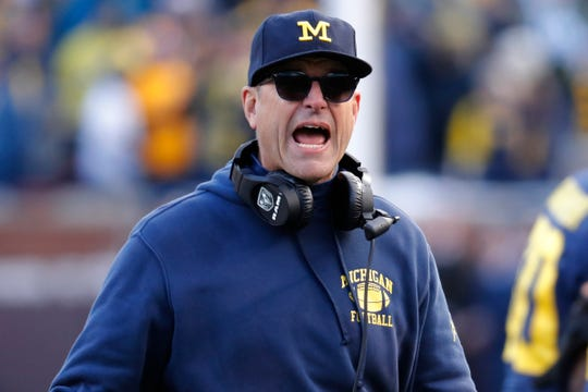 Michigan coach Jim Harbaugh reacts during the second half against Michigan State at Michigan Stadium, Nov. 16, 2019.