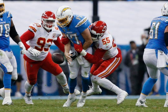 Chargers quarterback Philip Rivers, center, is sacked by Chiefs defensive end Frank Clark (55) and defensive tackle Joey Ivie (93) during the second half on Monday.