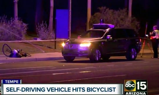 This image taken from video provided by ABC-15 in Tempe, Arizona, shows investigators at the scene of a crash involving a self-driving Uber car that struck and killed a woman pushing a bicycle.