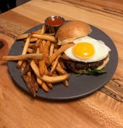 The Smith Burger is made from waygu from Sugarbush Farms that is marinated in soy-ginger. Upgrade from chips to fries for $2.