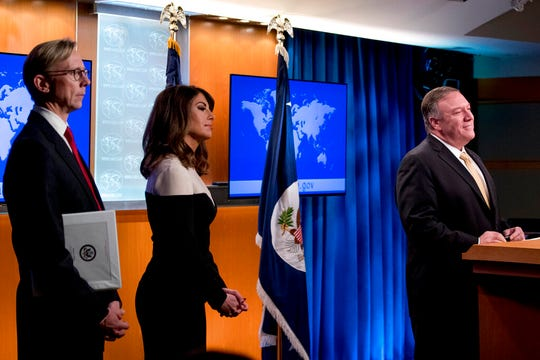 Secretary of State Mike Pompeo, right, accompanied by U.S. special representative on Iran Brian Hook, left, and State Department spokeswoman Morgan Ortagus, second from left, takes a question from a reporter during a news conference at the State Department in Washington, Monday, Nov. 18, 2019. Pompeo spoke about Iran, Iraq, Israeli settlements in the West Bank, protests in Hong Kong, and Bolivia, among other topics.