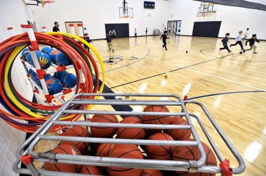 First-graders play games in the new, full-size gymnasium at Detroit Country Day School Lower School.
