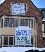 The Psi Upsilon chapter at the University of Michigan has faced criticism over a banner that referenced serial sex abuser Larry Nassar.
