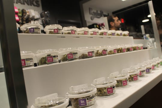 Products sit on shelves inside Ann Arbor-based Exclusive Brands on Tuesday, Nov. 19, 2019, the day the business became the first licensed recreational marijuana retailer in Michigan.