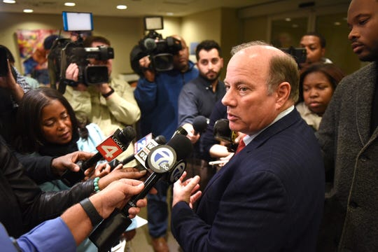 Detroit Mayor Mike Duggan talks to reporters in the lobby of his office at City Hall after the City Council on Tuesday voted down a contentious proposal to put a $250 million bond before city voters in the spring.