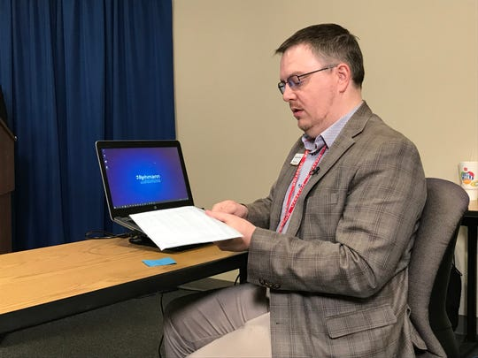Stephen Blann, a CPA with Rehmann LLC, prepares to randomly select 250,000 Michigan residents who will be sent applications to participate in the Independent Citizens Redistricting Commission on Tuesday, Nov. 19, 2019.