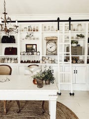 """Vintage clocks and other items add a cozy factor to built-in shelves styled by west Michigan author and blogger Liz Marie Galvan in her new book, """"Cozy White Cottage."""""""